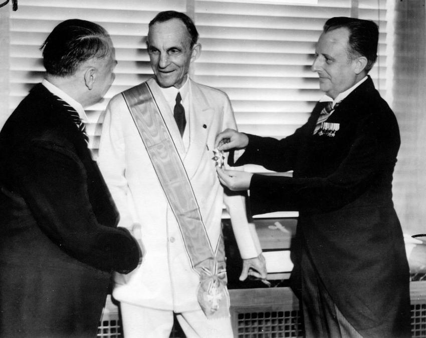 Henry Ford receiving the Grand Cross of the German Eagle from Nazi officials. 1938