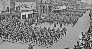 Soldiers march down Main Street, Sault Ste. Marie, MI, 1940's. (MyNorth)