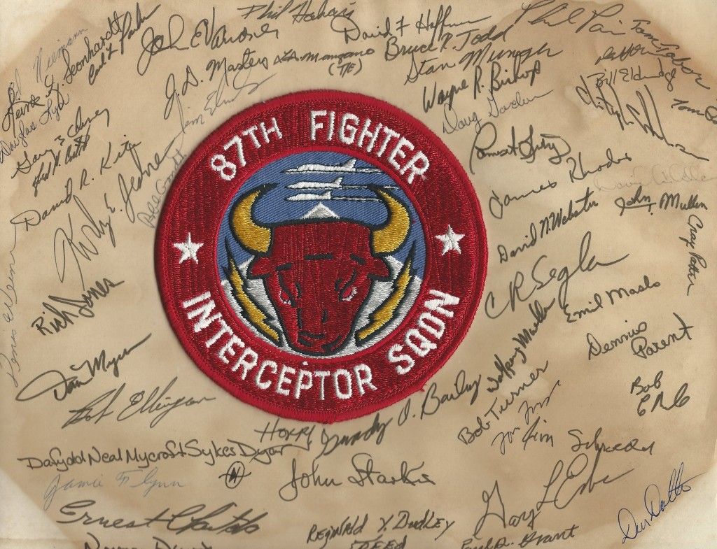The patch of the 87th FIS surrounded by the signatures of those who served in it. (Photo courtesy of John Roznick)