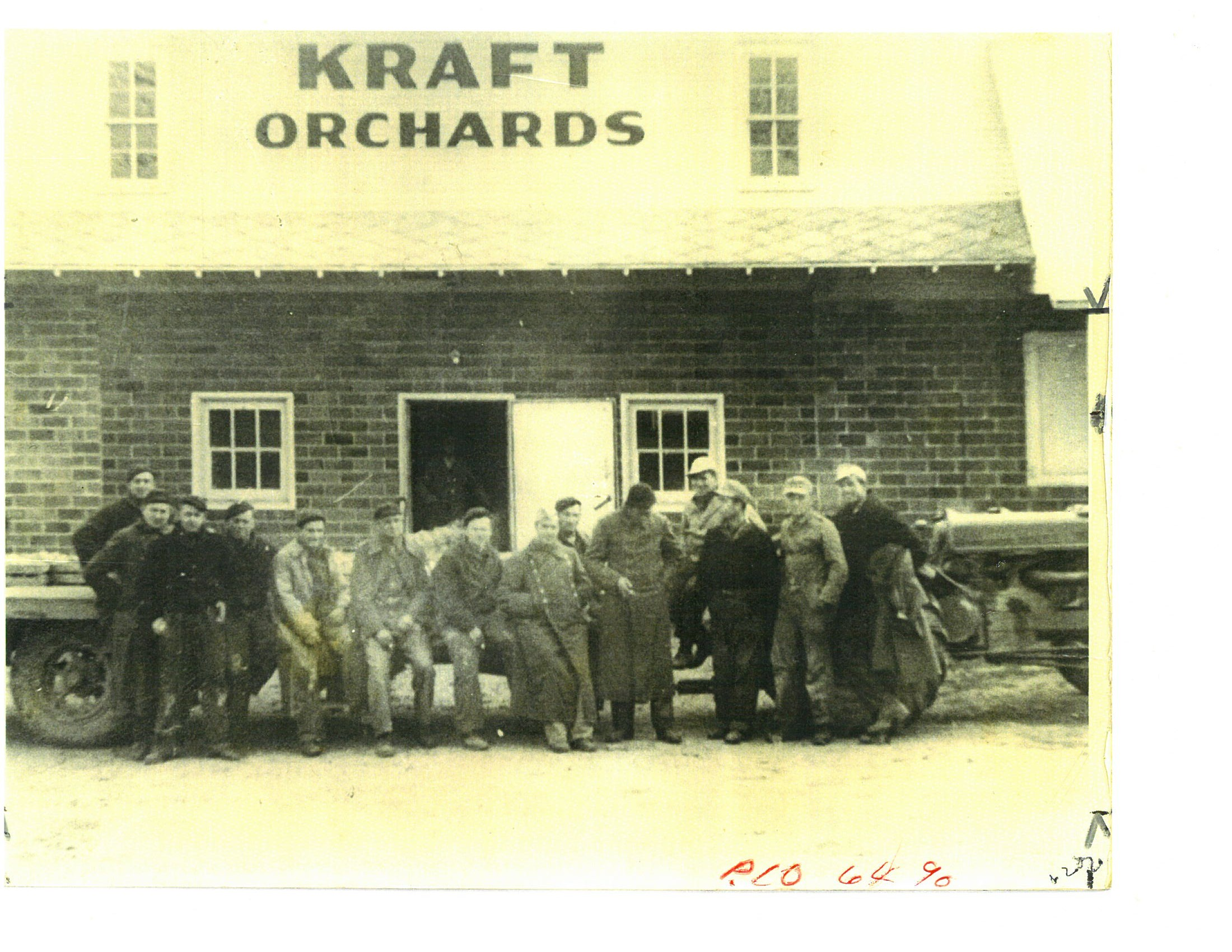 POW's standing in front of Kraft Orchard's Barn where they were employed - Use of Photo courtesy of Sparta Township Historical Commision